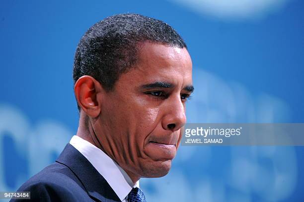US President Barack Obama speaks during a plenary session at the Bella Center in Copenhagen on December 18 2009 on the 12th day of the COP15 UN...