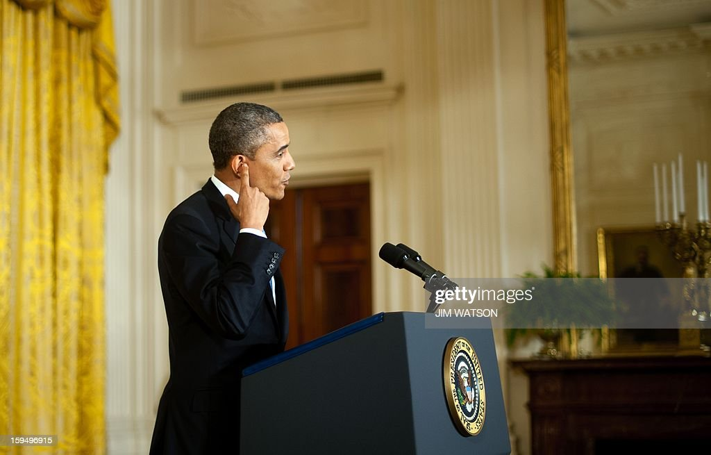 US President Barack Obama speaks during a press conference at the White House in Washington on January 14, 2013. Obama warned of a new economic crisis and said global stock markets would go 'haywire' unless Republicans in Congress agree to raise the US sovereign debt ceiling. AFP PHOTO/Jim WATSON
