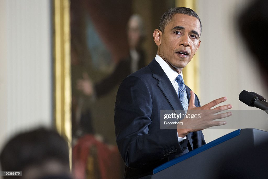"U.S. President Barack Obama speaks during a press conference in the East Room of the White House in Washington, D.C., U.S., on Wednesday, Nov. 14, 2012. Obama said voters sent a ""very clear message"" on Nov. 6 that they want both parties to stop bickering over politics and take the necessary steps to cut the budget deficit through a combination of tax increases for the wealthy and cuts in spending. Photographer: Joshua Roberts/Bloomberg via Getty Images"