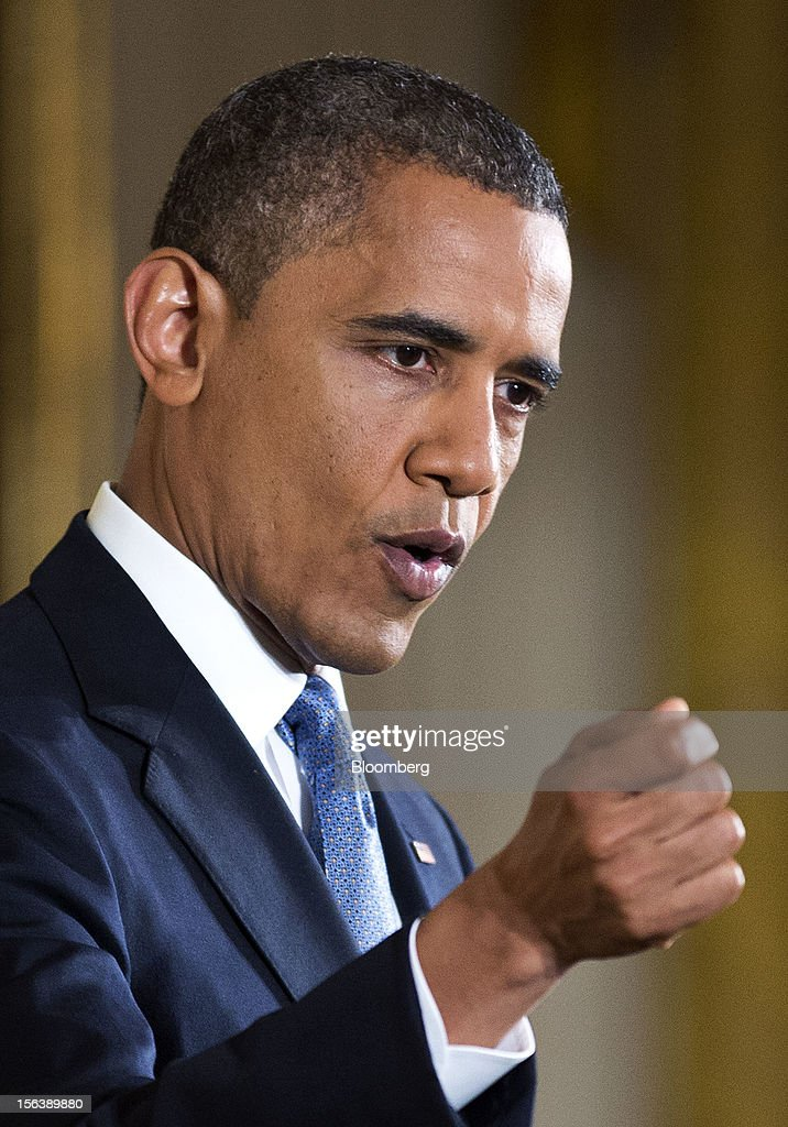 "U.S. President <a gi-track='captionPersonalityLinkClicked' href=/galleries/search?phrase=Barack+Obama&family=editorial&specificpeople=203260 ng-click='$event.stopPropagation()'>Barack Obama</a> speaks during a press conference in the East Room of the White House in Washington, D.C., U.S., on Wednesday, Nov. 14, 2012. Obama said voters sent a ""very clear message"" on Nov. 6 that they want both parties to stop bickering over politics and take the necessary steps to cut the budget deficit through a combination of tax increases for the wealthy and cuts in spending. Photographer: Joshua Roberts/Bloomberg via Getty Images"