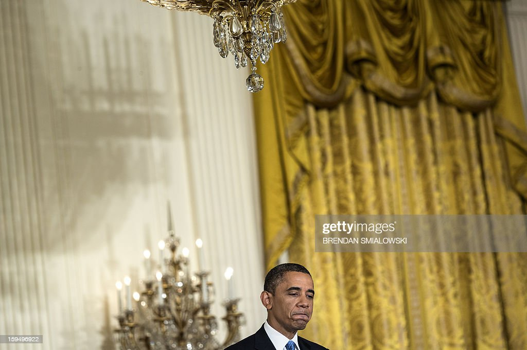 US President Barack Obama speaks during a press conference in the East Room of the White House on January 14, 2013 in Washington. Obama warned of a new economic crisis and said global stock markets would go 'haywire' unless Republicans in Congress agree to raise the US sovereign debt ceiling. AFP PHOTO/Brendan SMIALOWSKI