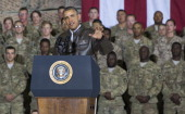 US President Barack Obama speaks during a surprise visit with US troops at Bagram Air Field north of Kabul in Afghanistan May 25 prior to the...