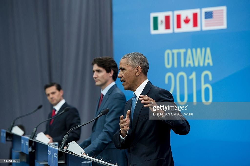 US President Barack Obama speaks during a trilateral press conference with President Enrique Pena Nieto, Canadian Prime Minister Justin Trudeau at the North American Leaders Summit at the National Gallery of Canada June 29, 2016 in Ottawa, Ontario. / AFP / Brendan Smialowski