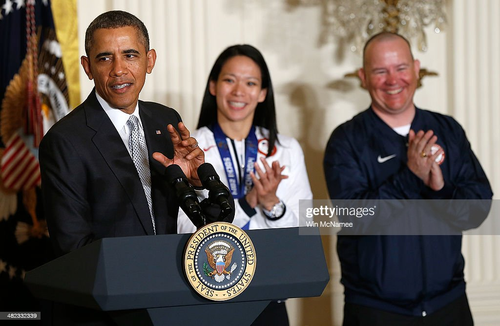 U.S. President <a gi-track='captionPersonalityLinkClicked' href=/galleries/search?phrase=Barack+Obama&family=editorial&specificpeople=203260 ng-click='$event.stopPropagation()'>Barack Obama</a> speaks during an event honoring the 2014 Olympic and Paralympic teams with Jon Lujan (R) and Julie Chi (C) at the White House April 3, 2014 in Washington, DC. Obama congratulated the Olympians and Paralympians on their performance and thanked them for representing the U.S. during the 2014 Olympic Winter Games in Sochi, Russia.