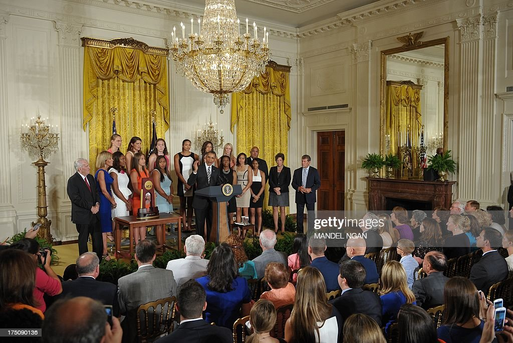 US President <a gi-track='captionPersonalityLinkClicked' href=/galleries/search?phrase=Barack+Obama&family=editorial&specificpeople=203260 ng-click='$event.stopPropagation()'>Barack Obama</a> speaks during an event in honor of the 2013 NCAA Womens Basketball Champions, the University of Connecticut Huskies, in the East Room of the White House on July 31, 2013 in Washington, DC. AFP PHOTO/Mandel NGAN