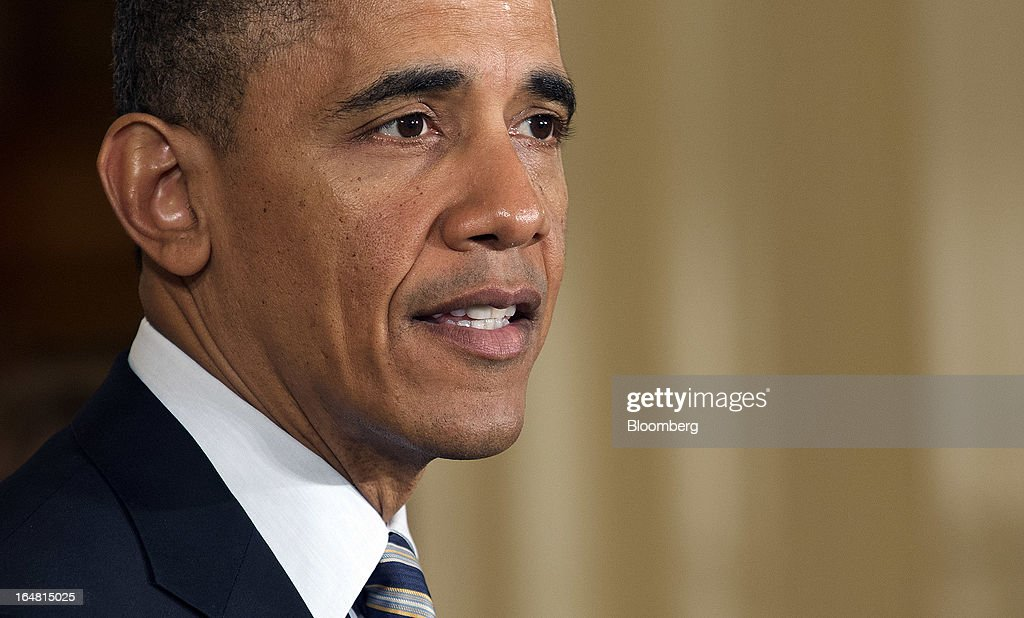 U.S. President <a gi-track='captionPersonalityLinkClicked' href=/galleries/search?phrase=Barack+Obama&family=editorial&specificpeople=203260 ng-click='$event.stopPropagation()'>Barack Obama</a> speaks during an event in the East Room of the White House in Washington, D.C., U.S., on Thursday, March 28, 2013. Obama, with families of victims of the Connecticut school shooting tragedy at his side, pressed the Senate to pass gun-control legislation next month and urged lawmakers to resist any weakening of resolve. Photographer: Joshua Roberts/Bloomberg via Getty Images