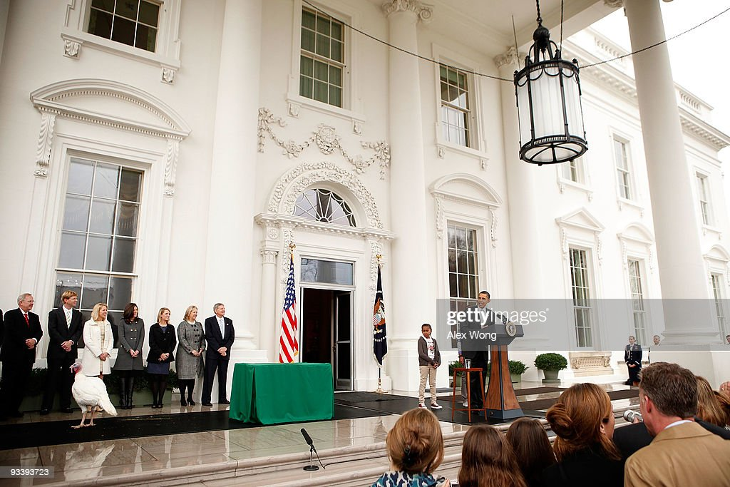 S President Barack Obama speaks during an event to pardon a turkey named 'Courage' at the North Portico of the White House November 25 2009 in...