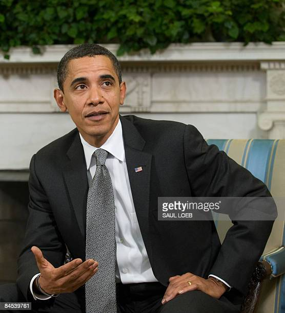 US President Barack Obama speaks during meetings with Treasury Secretary Timothy Geithner and US Vice President Joe Biden in the Oval Office of the...