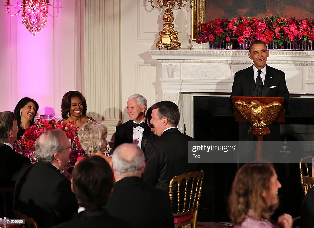 U.S. President <a gi-track='captionPersonalityLinkClicked' href=/galleries/search?phrase=Barack+Obama&family=editorial&specificpeople=203260 ng-click='$event.stopPropagation()'>Barack Obama</a> speaks during the 2014 Governors' Dinner on February 23, 2014 in Washington, DC. Reacting to the president's remarks are Governor <a gi-track='captionPersonalityLinkClicked' href=/galleries/search?phrase=Nikki+Haley+-+Gouverneur&family=editorial&specificpeople=6974701 ng-click='$event.stopPropagation()'>Nikki Haley</a> (R-SC), left, <a gi-track='captionPersonalityLinkClicked' href=/galleries/search?phrase=Michelle+Obama&family=editorial&specificpeople=2528864 ng-click='$event.stopPropagation()'>Michelle Obama</a>, and Governor <a gi-track='captionPersonalityLinkClicked' href=/galleries/search?phrase=Mike+Pence&family=editorial&specificpeople=812418 ng-click='$event.stopPropagation()'>Mike Pence</a> (R-IN). President Obama and the first lady hosted the annual event in the State Dining Room of the White House .
