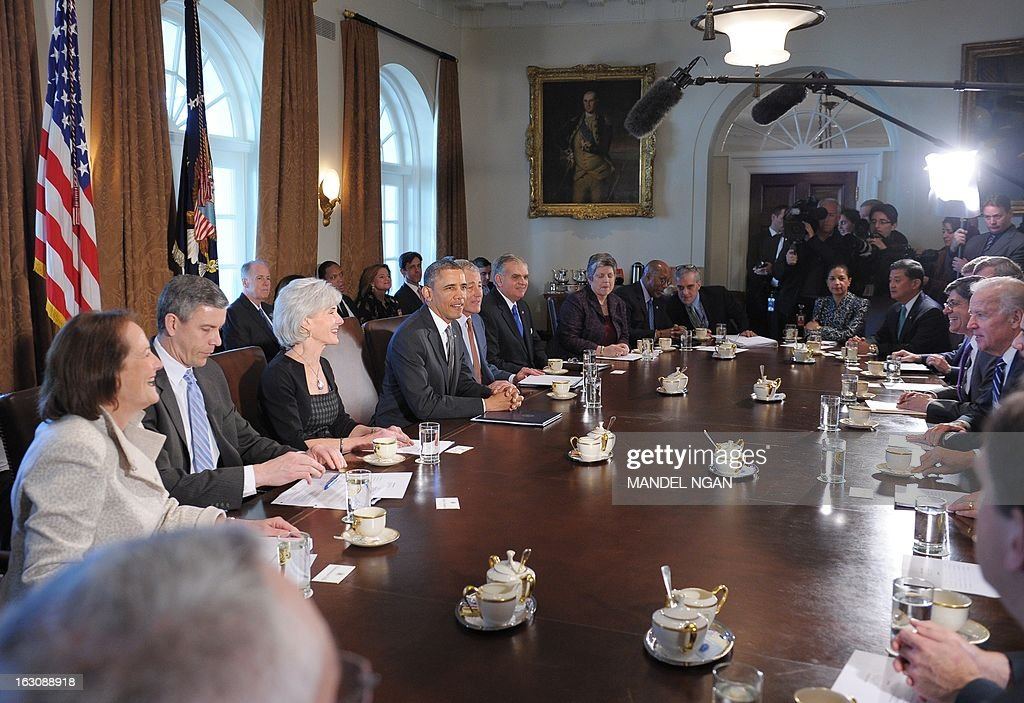 US President Barack Obama speaks during the first cabinet of his second term on March 4, 2013 in the Cabinet Room of the White House in Washington, DC. From left: Small Business Administration administrator Karen Mills, Education Secretary Arne Duncan, Health and Human Services Secretary Kathleen Sebelius, Obama, Defense Secretary Chuck Hagel, Transport Secretary Ray LaHood, Homeland Security Secretary Janet Napolitano, United States Trade Representative Ron Kirk, White House Chief of Staff Dennis McDonough, Ambassador to the United Nations Susan Rice, Veterans Affairs Secretary Eric Shinseki, Treasury Secretary Jacob Lew and US Vice President Joe Biden. AFP PHOTO/Mandel NGAN