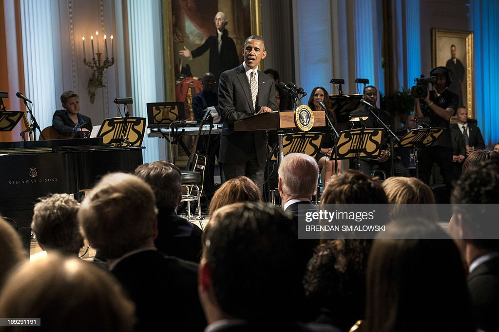 US President Barack Obama speaks during the Gershwin Prize Concert in the East Room of the White House May 22, 2013 in Washington, DC. The Obamas hosted the performance to honor singer and song writer Carole King's Gershwin Prize. AFP PHOTO/Brendan SMIALOWSKI