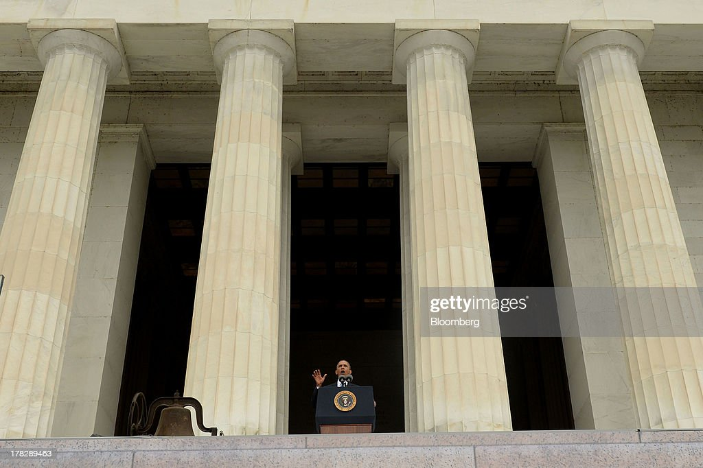 U.S. President Barack Obama speaks during the Let Freedom Ring commemoration event at the Lincoln Memorial in Washington, D.C., U.S., on Wednesday, Aug. 28, 2013. Obama, speaking from the same Washington stage where Martin Luther King Jr. delivered a defining speech of the civil rights movement, said that even as the nation has been transformed, work remains in countering growing economic disparities. Photographer: Michael Reynolds/Pool via Bloomberg