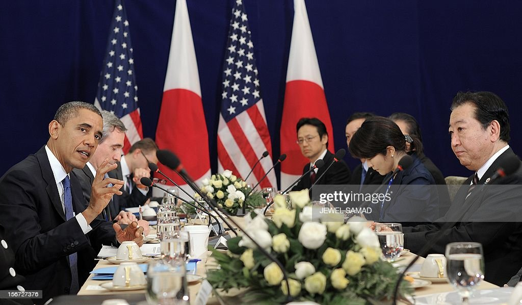 US President Barack Obama (L) speaks during the start of a bilateral meeting with Japanese Prime Minister Yoshihiko Noda (R) on the sidelines of the East Asian Summit at the Peace Palace in Phnom Penh on November 20, 2012. During the two-day East Asia Summit in Phnom Penh, Obama was scheduled to hold talks with the leaders of the 10-member Association of Southeast Asian Nations (ASEAN) along with Chinese Premier Wen Jiabao and Japan's Yoshihiko Noda. AFP PHOTO / Jewel Samad