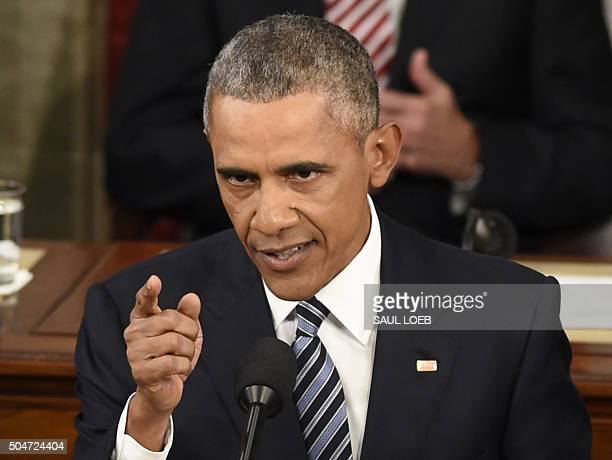 US President Barack Obama speaks during the State of the Union Address during a Joint Session of Congress at the US Capitol in Washington DC January...