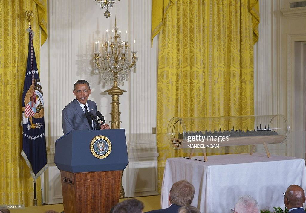 US President <a gi-track='captionPersonalityLinkClicked' href=/galleries/search?phrase=Barack+Obama&family=editorial&specificpeople=203260 ng-click='$event.stopPropagation()'>Barack Obama</a> speaks during the White House Maker Faire on June 18, 2014 in the East Room of the White House in Washington, DC. At right is a 3-D visualization of Obama's 2013 State of the Union address. AFP PHOTO/Mandel NGAN