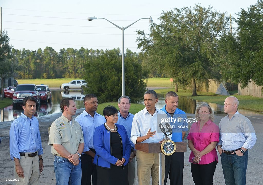 US President Barack Obama speaks following a visit in LaPlace, Saint John the Baptist Parish, Louisiana to view damage caused by Hurricane Isaac September 3, 2012. Also pictured are: Louisiana Governor Bobby Jindal (L), Saint John the Baptist Parish President Natalie Robottom (4th L), Saint John the Baptist Parish Sheriff Mike K. Tregre (3rd R), Senator Mary Landrieu, and New Orleans Mayor Mitch Landrieu. AFP PHOTO/Mandel NGAN