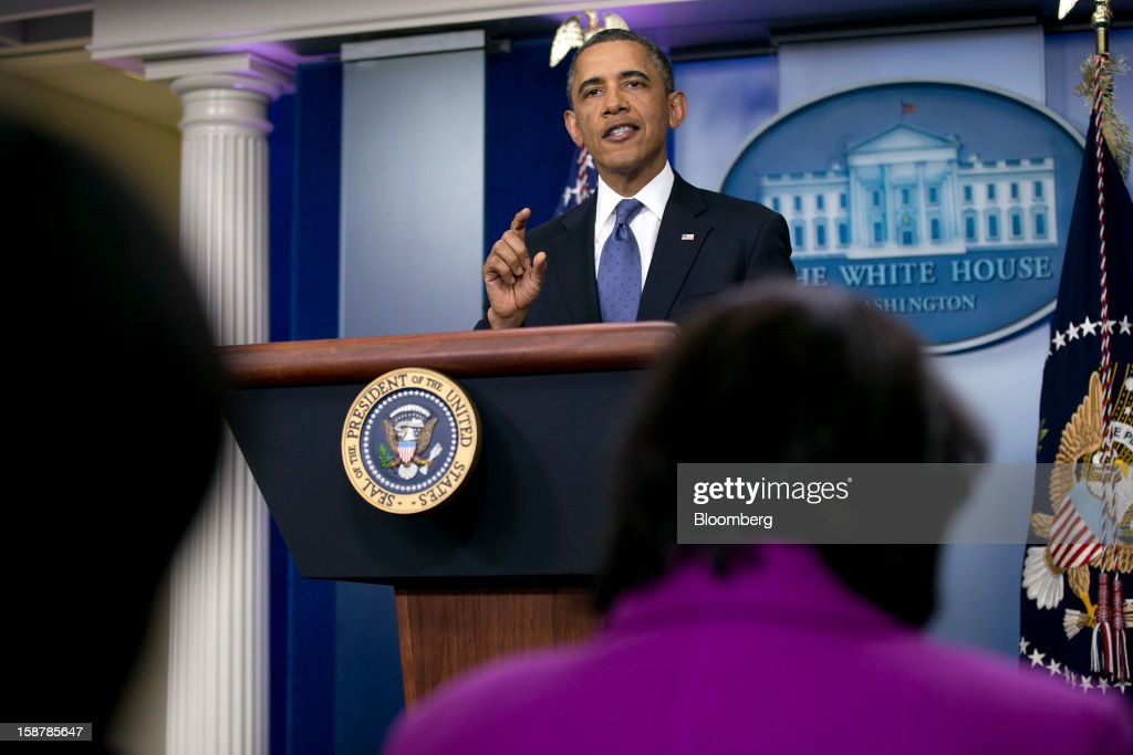 U.S. President Barack Obama speaks in the Brady Press Briefing Room at the White House in Washington, D.C., U.S., on Friday, Dec. 28, 2012. Obama is seeking an up-or-down vote on his proposal to extend tax cuts for annual income up to $250,000, absent a counteroffer from congressional leaders, an official familiar with today's budget talks said. Photographer: Andrew Harrer/Bloomberg via Getty Images
