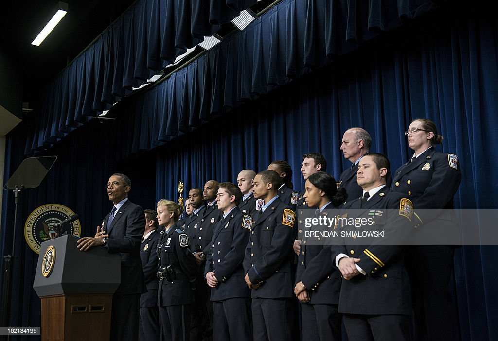 US President Barack Obama speaks in the Eisenhower Executive Office Building on the White House campus, joined by emergency responders on February 19, 2013 in Washington, DC. Obama spoke about the upcoming spending cuts know as the sequester to go into effect next month if the Congress and Obama administration can not agree on federal spending. AFP PHOTO/Brendan SMIALOWSKI