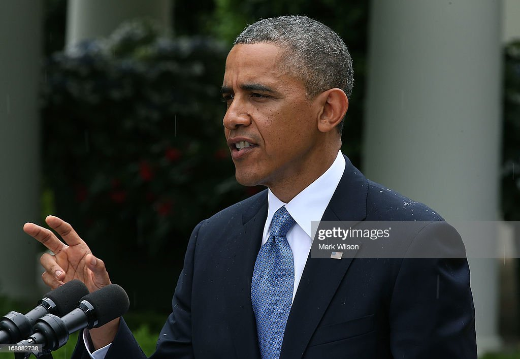 U.S. President <a gi-track='captionPersonalityLinkClicked' href=/galleries/search?phrase=Barack+Obama&family=editorial&specificpeople=203260 ng-click='$event.stopPropagation()'>Barack Obama</a> speaks in the rain during a news conference with Prime Minister Recep Tayyip Erdogan of Turkey (not shown), in the Rose Garden at the White House, May 16, 2013 in Washington, DC. President Obama answered questions on the IRS Justice Department invesigation and talked about the situation with Syria.