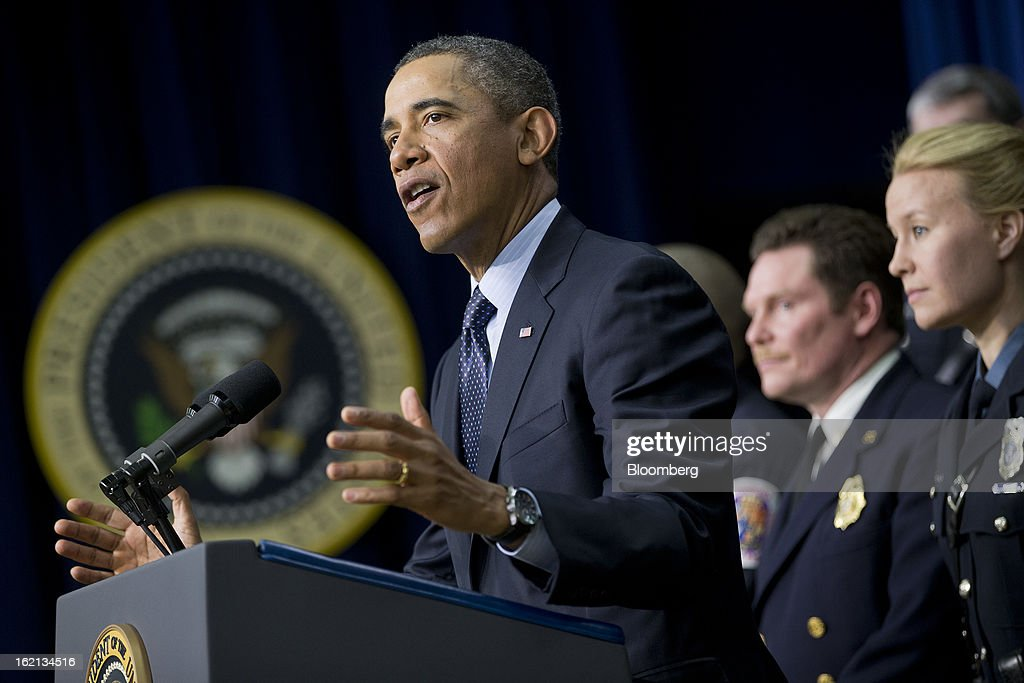 U.S. President <a gi-track='captionPersonalityLinkClicked' href=/galleries/search?phrase=Barack+Obama&family=editorial&specificpeople=203260 ng-click='$event.stopPropagation()'>Barack Obama</a> speaks in the South Court Auditorium of the Eisenhower Executive Building next to the White House with emergency responders, right, in Washington, D.C., U.S., on Tuesday, Feb. 19, 2013. Obama stepped up pressure on Congress to avert 'brutal' automatic $1.2 trillion in budget cuts set to kick in March 1, saying it would harm the economy and curtail vital services. Photographer: Andrew Harrer/Bloomberg via Getty Images