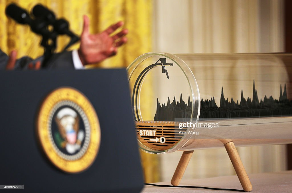 U.S. President <a gi-track='captionPersonalityLinkClicked' href=/galleries/search?phrase=Barack+Obama&family=editorial&specificpeople=203260 ng-click='$event.stopPropagation()'>Barack Obama</a> speaks next to a 3D-printed sculpture of his State of the Union Address during the first ever White House Maker Faire June 18, 2014 in the East Room of the White House in Washington, DC. The event was to showcase people who are using new tools and techniques to create new businesses for American manufacturing and to promote for more access for bringing new ideas to life.
