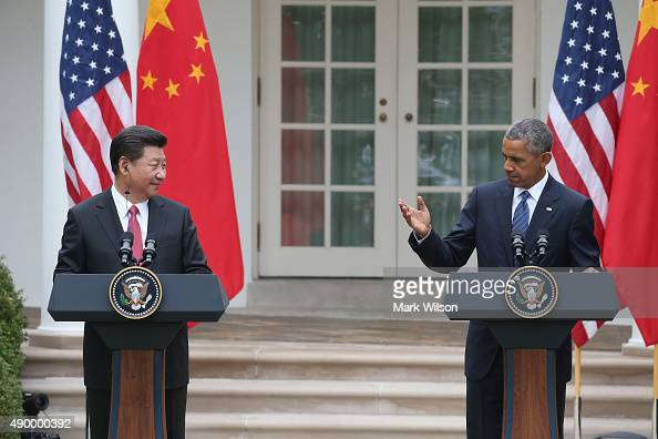 S President Barack Obama speaks next to Chinese President Xi Jinping at a joint press conference in the Rose Garden at The White House on September...