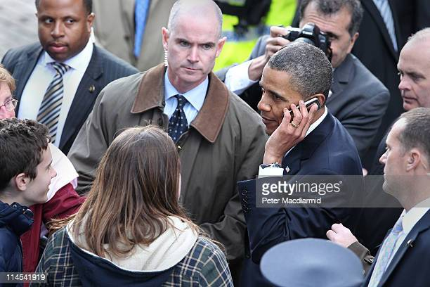 S President Barack Obama speaks on a mobile telephone belonging to an audience member in College Green on May 23 2011 in Dublin Ireland Obama is...