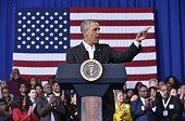 US President Barack Obama speaks on stage at a town hall meeting at McKinley Senior High School on January 14 2016 in Baton Rouge Louisiana / AFP /...