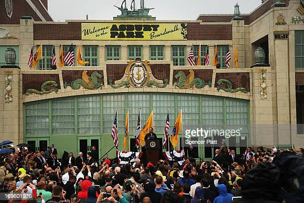 President Barack Obama speaks to crowds along a rain soaked boardwalk in Asbury Park on May 28 2013 in Asbury Park New Jersey Seven months after...