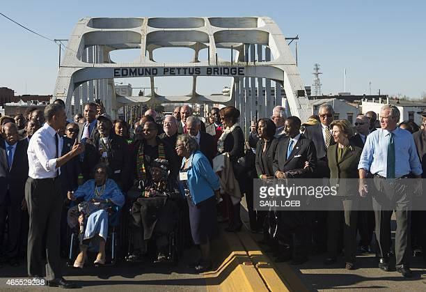 US President Barack Obama speaks to marchers including former US President George W Bush Laura Bush and US Representative John Lewis Democrat of...