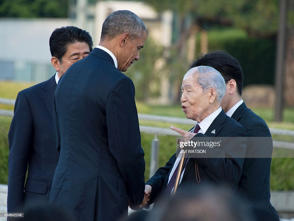 US President Barack Obama (2nd L) speaks to Sunao Tsuboi (2nd R), a survivor of the 1945 atomic bombing of Hiroshima, as Japan's Prime Minister Shinzo Abe (back L) looks on, during a visit to the Hiroshima Peace Memorial Park on May 27, 2016. Obama on May 27 paid moving tribute to victims of the world's first nuclear attack. WATSON