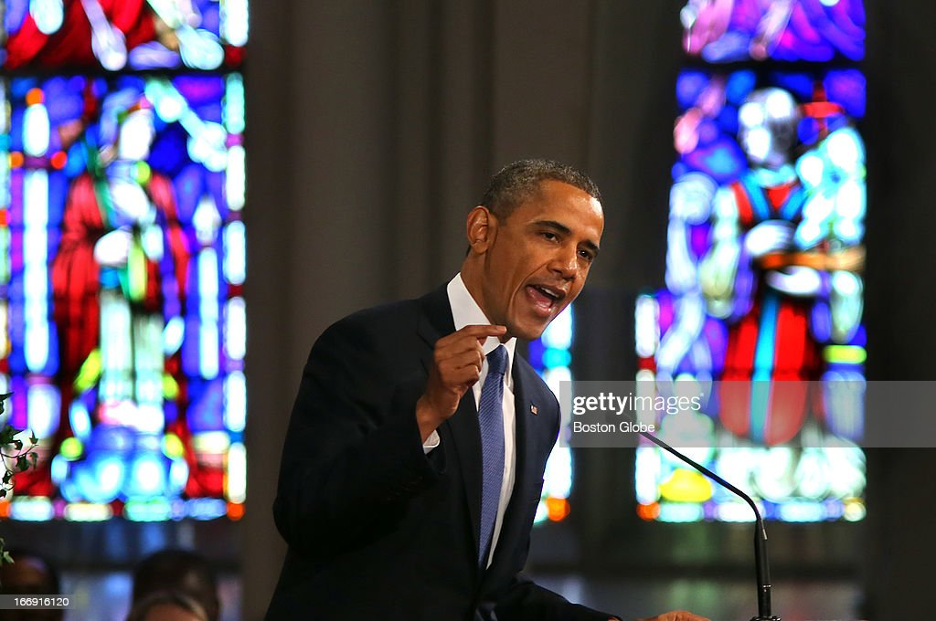 President Barack Obama speaks to the audience at the Cathedral of the Holy Cross in Boston during an interfaith healing service for the victims of the Boston Marathon bombing.