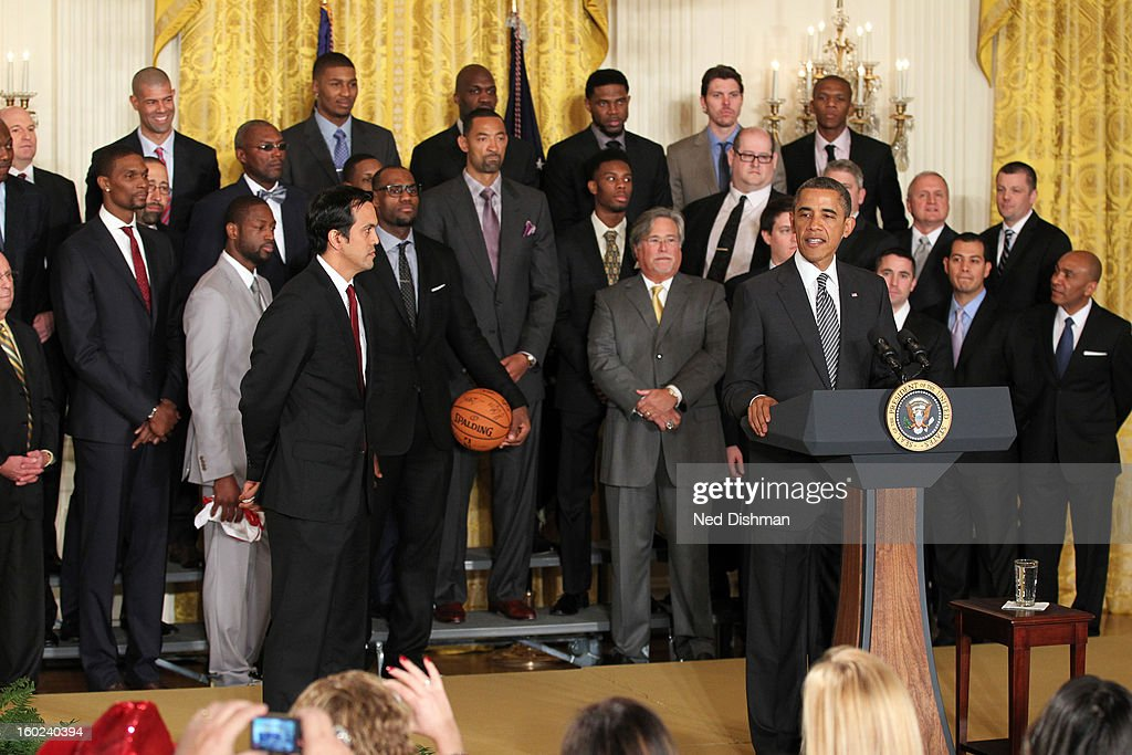 President <a gi-track='captionPersonalityLinkClicked' href=/galleries/search?phrase=Barack+Obama&family=editorial&specificpeople=203260 ng-click='$event.stopPropagation()'>Barack Obama</a> speaks to the crowd during a visit by the Miami Heat to the White House to commemorate the 2012 NBA Champions on January 28, 2013 in Washington, DC.