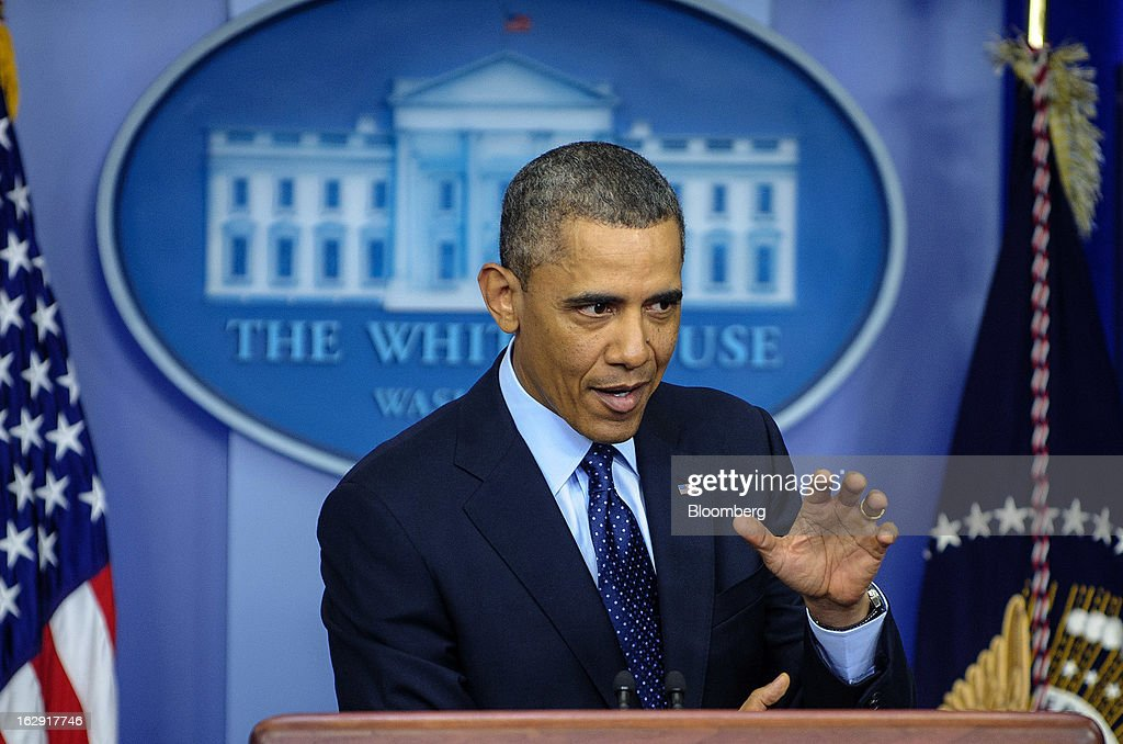 "U.S. President Barack Obama speaks to the media in the Brady Press Briefing Room at the White House in Washington, D.C., U.S., on Friday, March 1, 2013. Obama said the automatic spending cuts set to kick in today will be a ""slow grind"" on the economy and that it may take weeks to win over enough lawmakers from both parties to reach a deal on a replacement deficit-cutting plan. Photographer: Pete Marovich/Bloomberg via Getty Images"