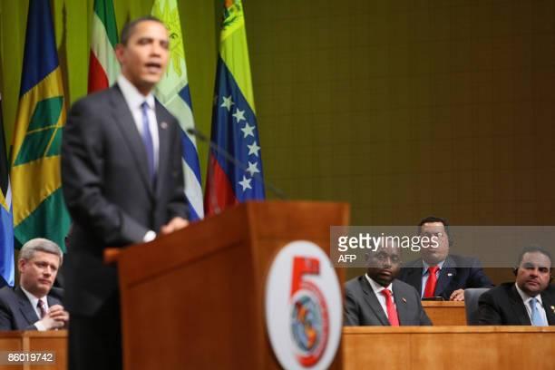 US President Barack Obama speaks while El Salvador's President Elias Antonio Saca Venezuela's President Hugo Chavez Dominica's Prime Minister...