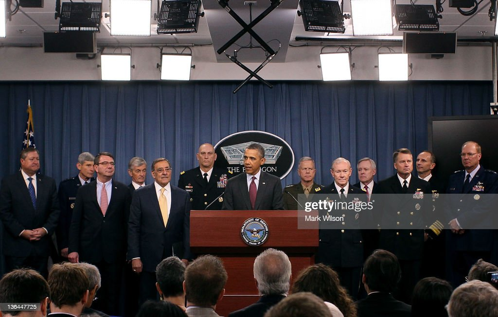 U.S. President <a gi-track='captionPersonalityLinkClicked' href=/galleries/search?phrase=Barack+Obama&family=editorial&specificpeople=203260 ng-click='$event.stopPropagation()'>Barack Obama</a> (C) speaks while flanked by Secretary of Defense Leon Panetta (5thL),Chairman of the Joint Chiefs of Staff Gen. <a gi-track='captionPersonalityLinkClicked' href=/galleries/search?phrase=Martin+Dempsey&family=editorial&specificpeople=2116621 ng-click='$event.stopPropagation()'>Martin Dempsey</a> (5thR), Chief of Staff U.S. Army Gen. Raymond Odierno (6thL), Commandant of the U.S. Marine Corps Gen. James Amos (6thR), and members of the Joint Chiefs at the Pentagon on January 5, 2012 in Washington, DC. President Obama announced U.S. Department of Defense strategic priorities that will guide Pentagon spending over the next 10 years.