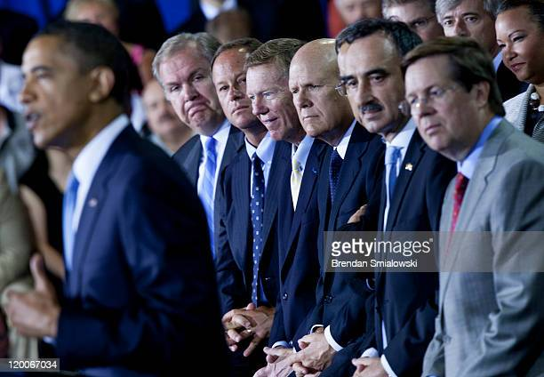 US President Barack Obama speaks while Mendel Executive Vice President of Automotive Operations American Honda Motor Co Doug Speck President and CEO...