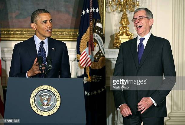 US President Barack Obama speaks while telecom industry lobbyist Tom Wheeler listens during a personnel announcement at the White House on May 1 2013...