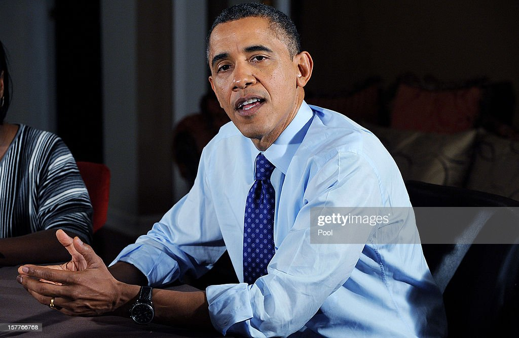 U.S. President <a gi-track='captionPersonalityLinkClicked' href=/galleries/search?phrase=Barack+Obama&family=editorial&specificpeople=203260 ng-click='$event.stopPropagation()'>Barack Obama</a> speaks while visiting a home to discuss his plan to extend tax cuts for 98 percent of Americans December 6, 2012 in Falls Church, Virginia. Obama went to the home of Tiffany and Richard Santana in suburban Virginia to push for the administrations plan to come to an agreement before the 'fiscal cliff' at the beginning of the year.