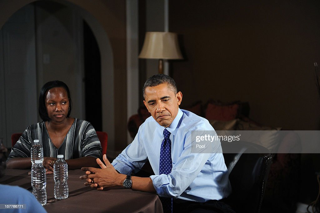 U.S. President Barack Obama (R) speaks while visiting a home to discuss his plan to extend tax cuts for 98 percent of Americans December 6, 2012 in Falls Church, Virginia. Obama went to the home of Tiffany and Richard Santana in suburban Virginia to push for the administrations plan to come to an agreement before the 'fiscal cliff' at the beginning of the year.