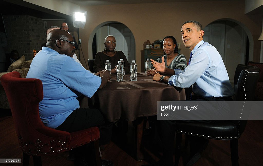 U.S. President <a gi-track='captionPersonalityLinkClicked' href=/galleries/search?phrase=Barack+Obama&family=editorial&specificpeople=203260 ng-click='$event.stopPropagation()'>Barack Obama</a> (R) speaks while visiting a home to discuss his plan to extend tax cuts for 98 percent of Americans December 6, 2012 in Falls Church, Virginia. Obama went to the home of Tiffany and Richard Santana in suburban Virginia to push for the administrations plan to come to an agreement before the 'fiscal cliff' at the beginning of the year.