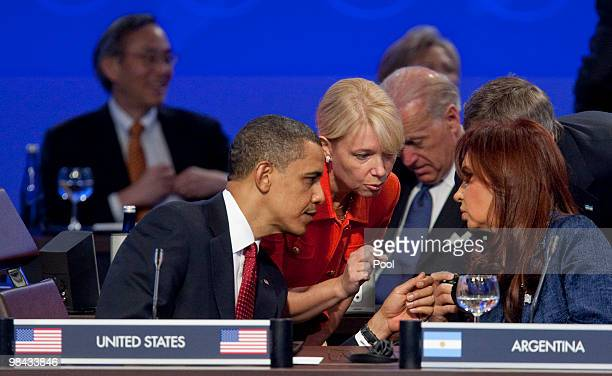 S President Barack Obama speaks with Argentina's President Cristina Fernandez de Kirchner during the opening plenary of the Nuclear Security Summit...