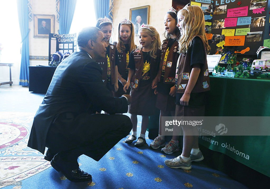 U.S. President Barack Obama (L) speaks with Avery Dodson, Natalie Hurley, Miriam Schaffer, Claire Winton and Lucy Claire Sharp, winners of the Junior FIRST Lego League Challenge, with the 'Flood-proof' bridge design project during the 2014 White House Science Fair at the White House May 27, 2014 in Washington, DC. Obama hosted the science fair to announce new steps as part of his Educate to Innovate campaign, and celebrated student winners of a range of science, technology, engineering and math (STEM) competitions from across the country.