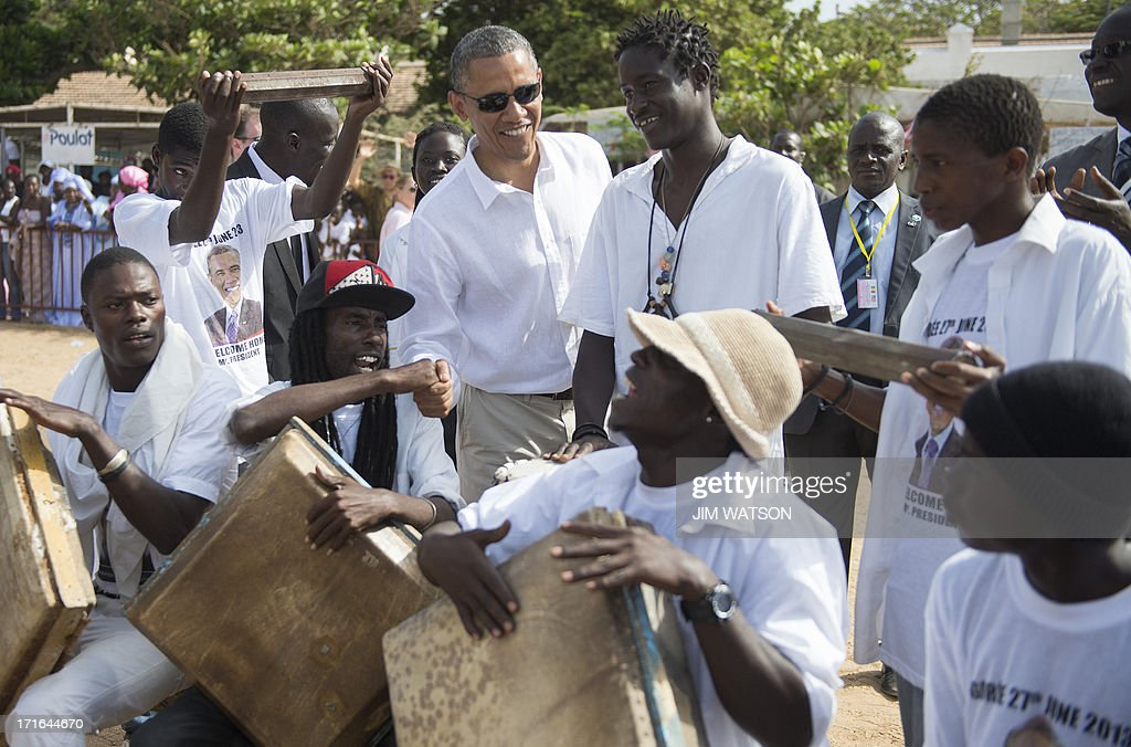 US President <a gi-track='captionPersonalityLinkClicked' href=/galleries/search?phrase=Barack+Obama&family=editorial&specificpeople=203260 ng-click='$event.stopPropagation()'>Barack Obama</a> (C) speaks with locals as he tours Goree Island off the coast of Dakar, Senegal on June 27, 2013.
