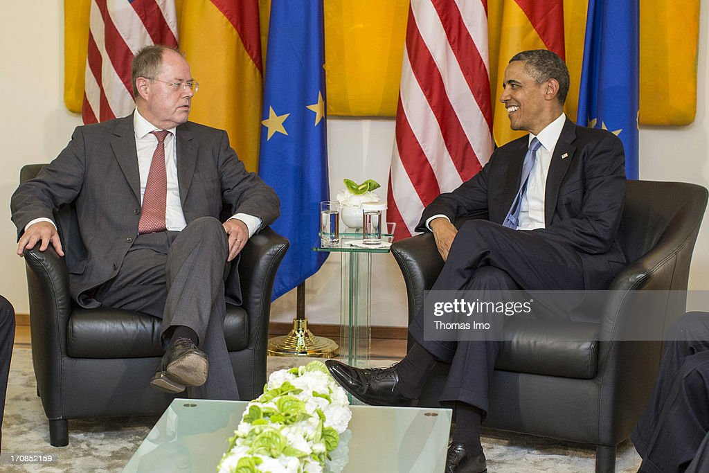 U.S. President <a gi-track='captionPersonalityLinkClicked' href=/galleries/search?phrase=Barack+Obama&family=editorial&specificpeople=203260 ng-click='$event.stopPropagation()'>Barack Obama</a> (R) speaks with <a gi-track='captionPersonalityLinkClicked' href=/galleries/search?phrase=Peer+Steinbrueck&family=editorial&specificpeople=209110 ng-click='$event.stopPropagation()'>Peer Steinbrueck</a>, Social Democratic candidate for chancellor, on June 19, 2013 in Berlin, Germany. Obama is set to speak on the east side of the Brandenburg Gate, 50 years after John F. Kennedy famously declared his solidarity with the citizens of Berlin.