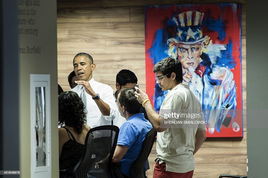 US President Barack Obama speaks with people at 1776, a tech startup hub, on July 3, 2014 in Washington, DC. Obama spoke about job growth as employers added 288,000 jobs in June, putting the unemployment rate to 6.1 percent, the lowest since September 2008, Labor Department data showed Thursday. AFP Photo/Brendan SMIALOWSKI