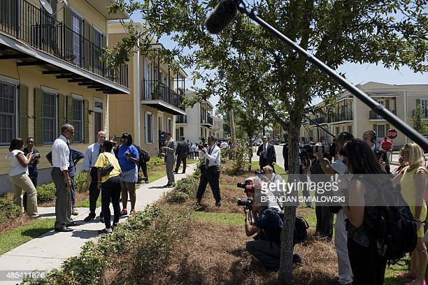 US President Barack Obama speaks with people during a tour of the Treme neighborhood August 27 2015 in New Orleans Louisiana President Obama visited...