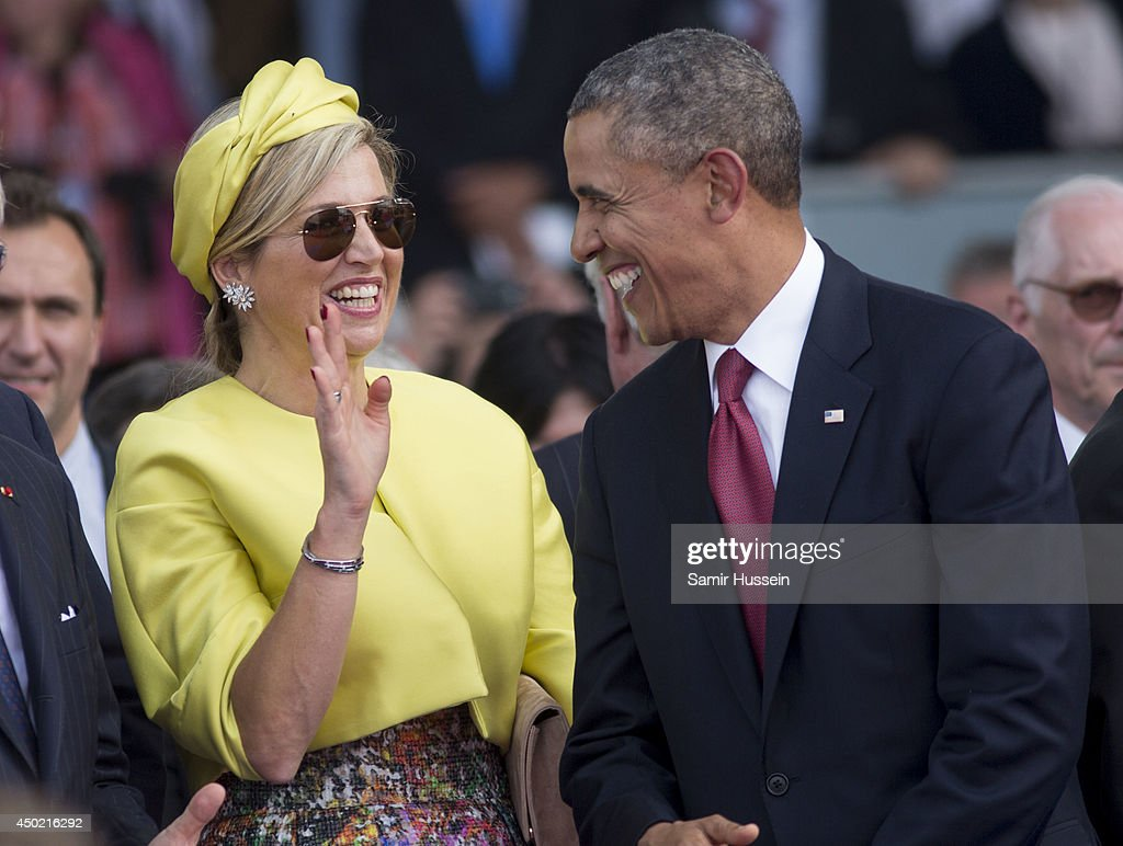 U.S. President Barack Obama speaks with Queen Maxima of Holland as they attend a Ceremony to Commemorate D-Day 70 on Sword Beach during D-Day 70 Commemorations on June 6, 2014 in Ouistreham, France.