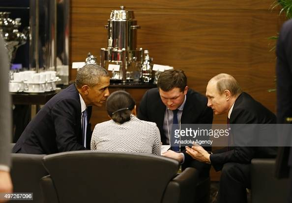 President Barack Obama speaks with Russian President Vladimir Putin prior to the opening session of the G20 Turkey Leaders Summit on November 15 2015...
