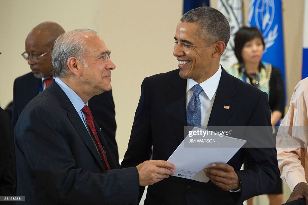 US President Barack Obama (R) speaks with Secretary-General of the Organization for Economic Co-operation and Development Angel Gurria (L) as they take part in a dialogue with world leaders at the G7 Summit in Shima in Mie prefecture on May 27, 2016. A British secession from the European Union in next month's referendum could have disastrous economic consequences, G7 leaders warned on May 27 at the close of the summit in Japan. / AFP / POOL / JIM